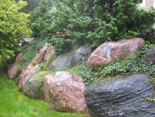 Majestic Rock Retaining Wall Laced With Myrtle.