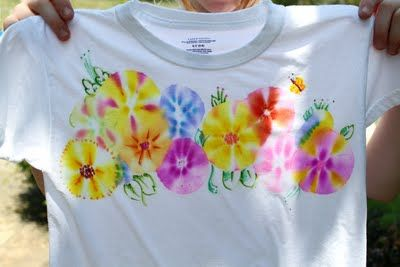 Flowers technique - tie dyed using sharpies and rubbing alcohol. More examples (on this page) and then a link to tutorial here: http://thebutterflyjungle.blogspot.com/2010/06/fireworks-t-shirts.html