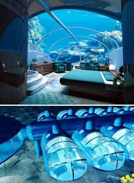 underwater motel The Poseidon Resort in Fiji. You can sleep on the ocean floor, and you even get a button to feed the fish right outside your window.
