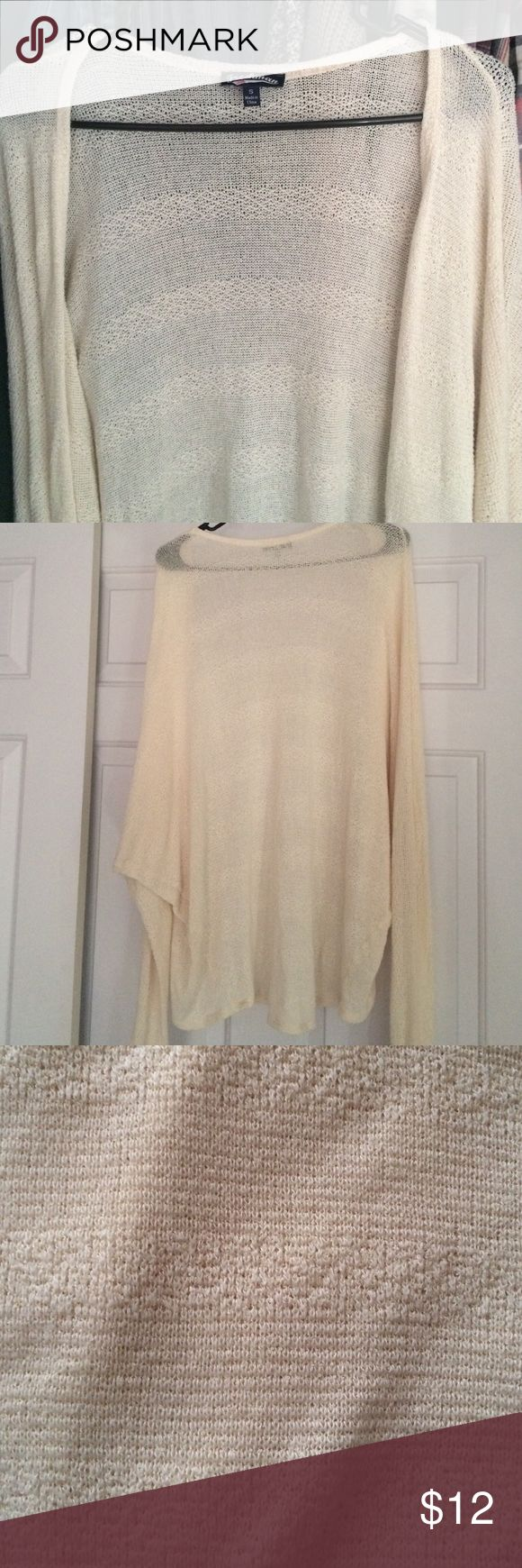 Dolman sleeved oversized cardigan Freshman brand oversized cream cardigan. Has a really cool striped texture. It is a small, but it is pretty big, it looks great with dresses. Reason for selling is just that it's not what I want anymore. It is pretty long, I'm about 5'4 and it goes down to my thighs. Freshman Sweaters Cardigans