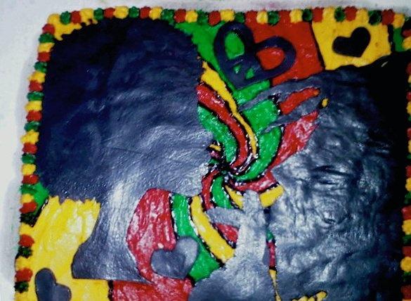 reggae style cake with cutouts of bob marley and erikah badu