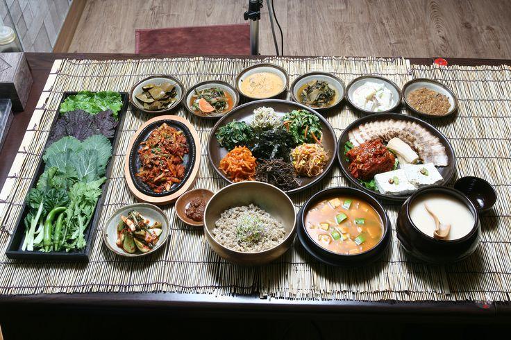 """밥상 Daily meal table. It always includes a rice bowl and lots of 반찬 """"side dishes."""""""