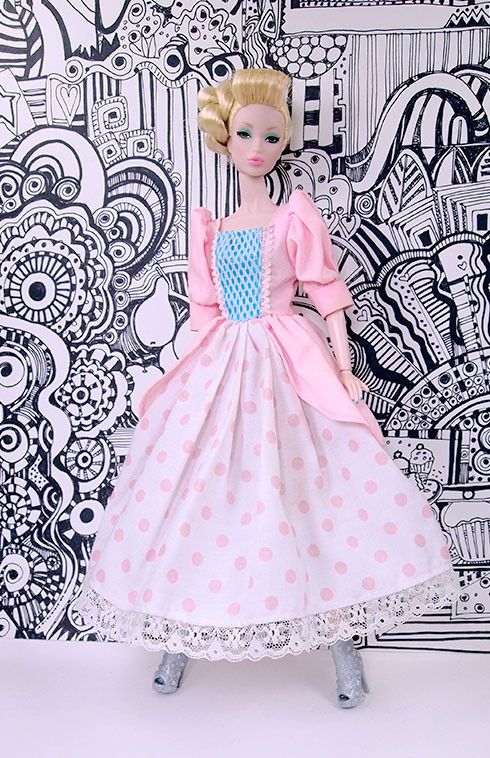 Take Princess to a new place with this adorable cotton Princess dress for day. Exquisitely crafted puff sleeves with cuffs, front blue panel with mesh and trim, peplum over a pink and white dot skirt