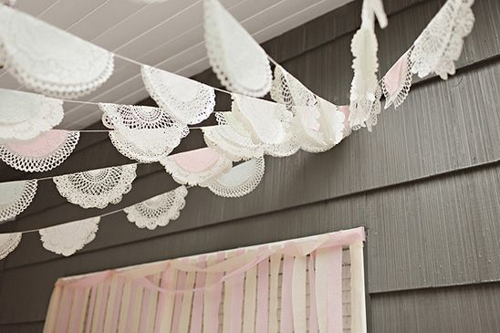 Doilies display at a pretty carousel themed birthday party, creative idea for a baby shower