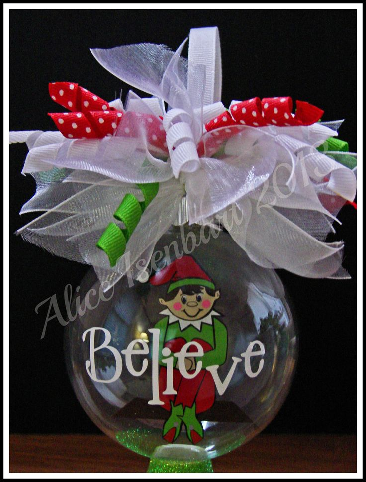 """Floating Ornament - elf ornament 3-1/4"""" - glass.  Layered Vinyl on Transparency Film.  """"Believe"""" phrase on outside of ornament."""