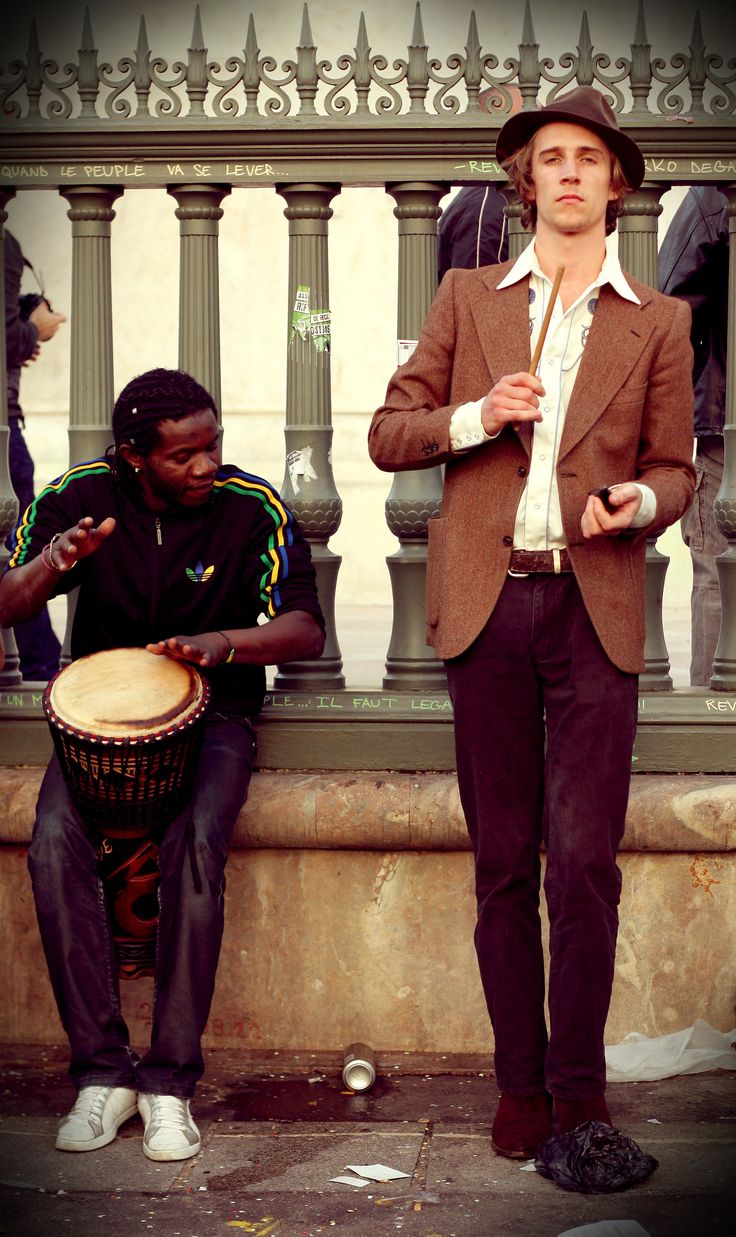 Street photography in Paris. Two musicians after in a demonstration.