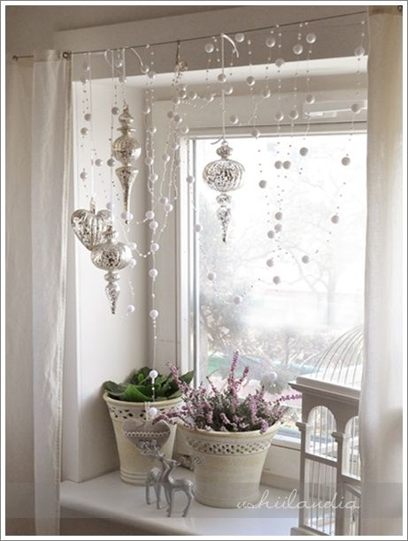 Festive ornaments & garland hanging in front of your windows! by HunnyBerri