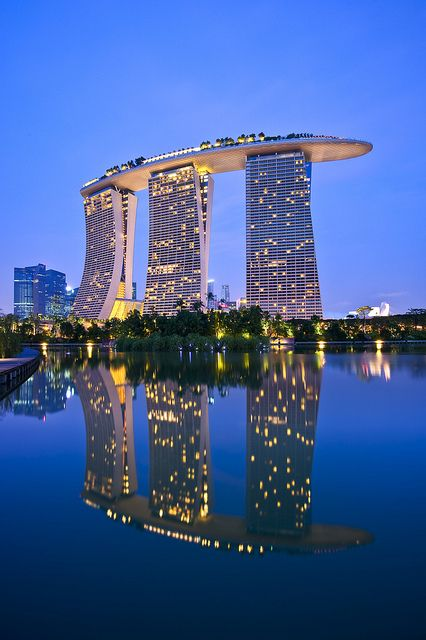 Marina Bay Sands in Singapore - Interesting shape: An Integrated Resort fronting Marina Bay in Singapore. Developed by Las Vegas Sands, it is billed as the world's most expensive standalone casino property at 8 billion dollars, including cost of the prime land. And that is a swimming pool (eternity pool) on the top floor!