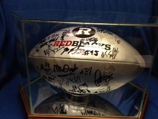 Ottawa RedBlacks Autographed Football in display case. Donated by Dan Donaghy, National Rent-to-Own. Retail value $400.00.