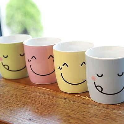 Happy and colorful porcelain mugs.