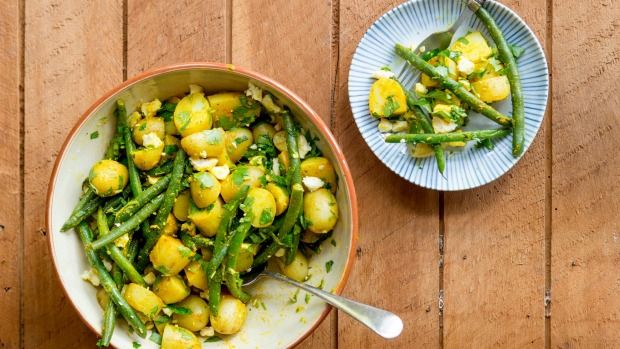 New potatoes with feta, beans, turmeric and parsley - Feta, tumeric and cumin seeds add an exotic edge to the ever-classic spuds.