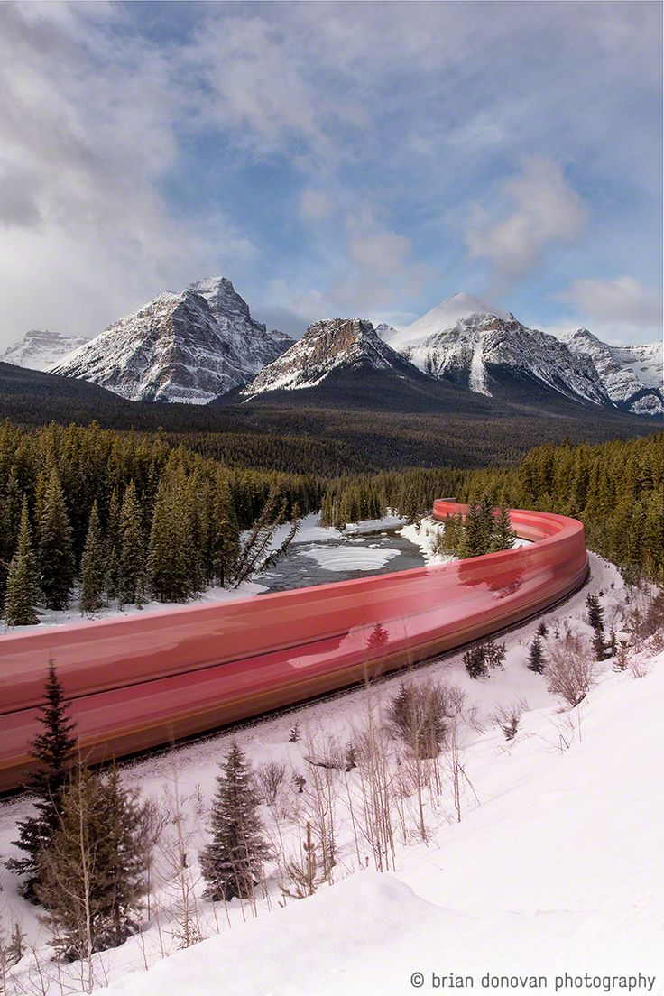 "Snake on a Train: A Long Exposure Photo of a Train Roaring through the Canadian Rockies ""over the course of two days he endured nearly 13 hours of sitting by the train tracks, where he saw only 6 trains coming from the wrong (less scenic) direction."""