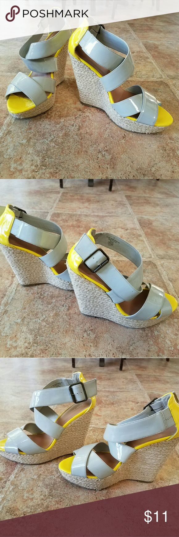 """Yellow & Gray Espadrille Sandals Platform Wedges Cute & sassy for Spring. Good condition platform espadrille wedge sandals. Vegan/man made. All flaws/scuffs are minor & representive of what is shown in last pic. Heel height is approx 5"""". Front lift is approx 1"""". Size 9. By Xhilaration. Selling because I bought them on Posh as props for covetshots, but we're unexpectedly making a cross-country move. I would like to pass them along to a new owner before the move.   Bundle for a discount & 1…"""