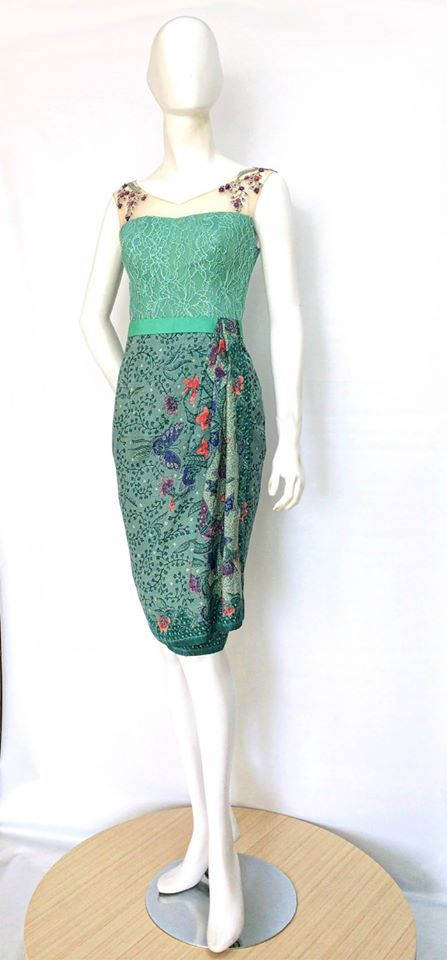 une Dress. This elegant June dress is embellished with 3D embroidery which mirrors the beautiful batik pattern on the skirt. Sophisticated and beautiful, the dress is perfect for a wedding in Bali or Sonoma.  For pricing, sizing, and ordering details please email us at nmayinda@gmail.com, Whatsapp us at 081299331039, or BB us at 2B07B968.