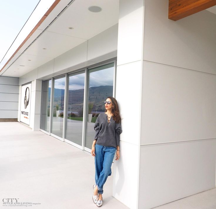 The Editors Notebook style blogger standing at the wine tasting room at Painted Rock Winery in Penticton, Okanagan, British Columbia #styleblogger #fashion #style #fashionblogger #styleinspiration #streetstyle #ootd #outfit #casual #denim #laceupsweater #calvinklein #silverloafers