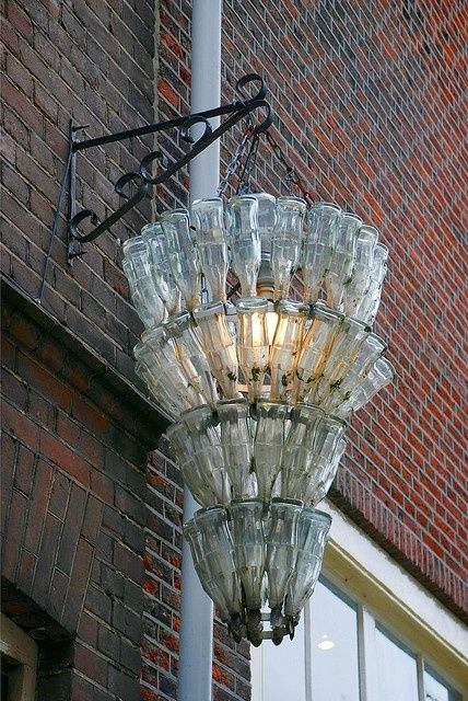A street lamp made out of recycled glass bottles