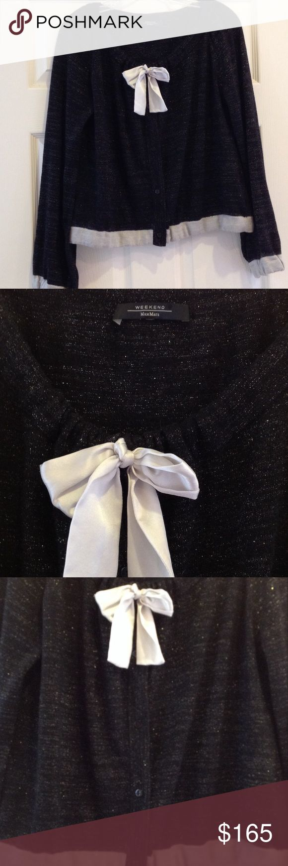 Weekend MaxMara women's black sweater. Size L. Weekend MaxMara women's black sweater with beige trim at bottom of sleeves and sweater. Button front closure with drawstring cream bow at neckline. Elastic at bottom of sweater and sleeves. Gold metallic thread throughout. 48% silk; 28% nylon; 14% metal; 5% wool; 5% angora. Size L. Weekend MaxMara Sweaters Cardigans