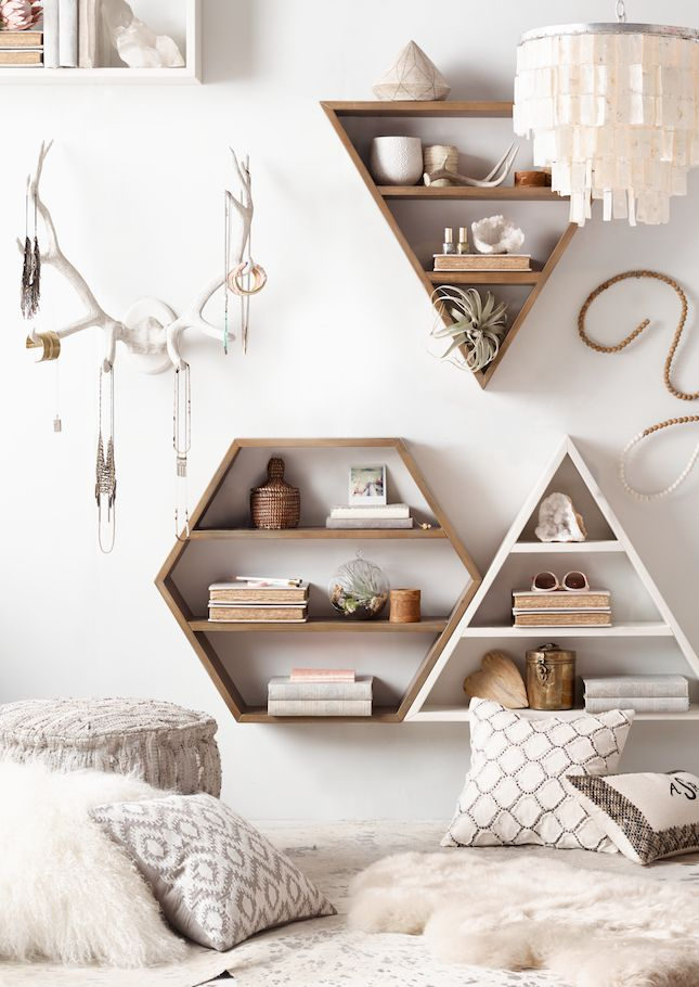 Featuring natural colors and clean lines, geometric wall shelves yield center stage to the items stored within.