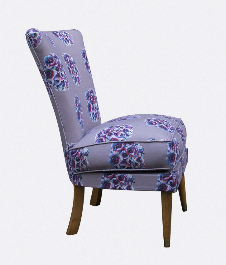 It's small size would make a perfect bedroom chair or sit comfortably as an addition to an elegant living room. We love its unique shape. Tapered at the bottom, with a plump cushion and perfect retro style legs.