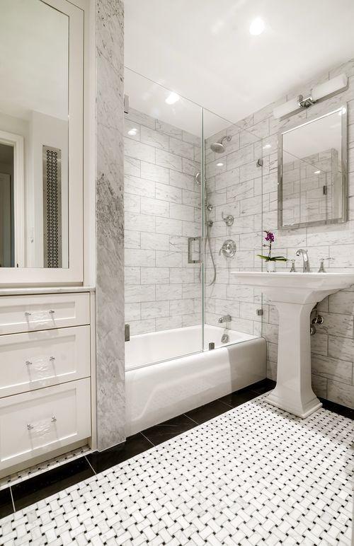 Basket Weave Tiles, Custom Cabinets, Marble Tiles, Small Bathrooms, tiles, pedestal sink, bathroom lighting, bathroom storage, tub and shower, tiled floor, grey tiles, sconce,