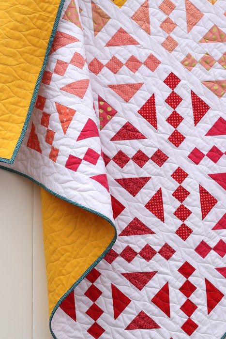 """Fresh new quilt patterns from the Fat Quarter Shop featuring paper-piecing templates perfect for Layer Cake (10"""" x 10"""") precut fabrics. Ombre Spectrum inspired quilt with Riley Blake Fabrics."""