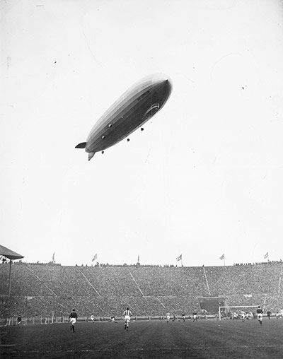 Credit: J. Gaiger/Getty Images 1929/30, Arsenal v Huddersfield Town The Graf Zeppelin sails over Wembley Stadium during the final