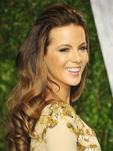 Long & Luscious. Kate Beckinsale's trick for show-stopper strands? A back-combed crown and buttery highlights.  Read more: Best Updos for Brides - Hair Ideas for Weddings - Real Beauty