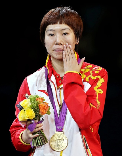 Li Xiaoxia wipes her tears after winning the women's table tennis singles