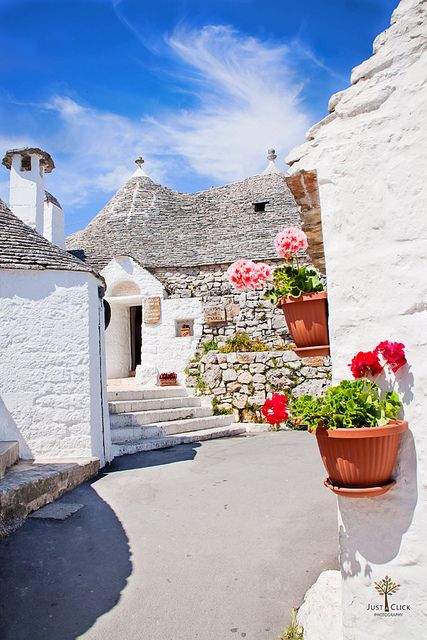 Puglia, Italy town of Alberobello - Trulli houses - the whole town is like this - all white...