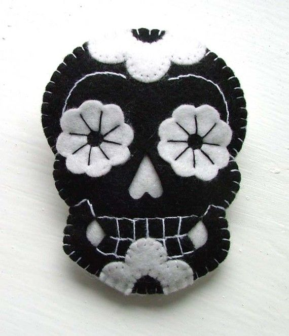 Day of the Dead Tattoo Skulls.  A matching PAIR of Black and White felt Sugar Skulls.  Hand stitched.  Lightly padded with brooch pin fastenings.  7cm x 9cm each.  *You are purchasing a PAIR of skulls as pictured*