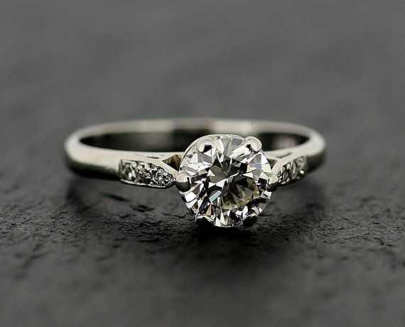 Diamond Engagement Ring - Vintage 1950s Diamond Engagement Ring With Diamond Shoulders in Platinum can't tell if I actually like this or not