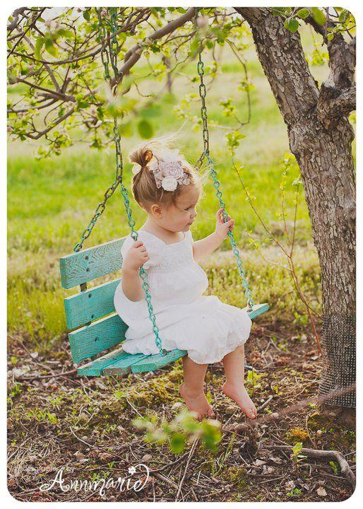 Precious girl swinging