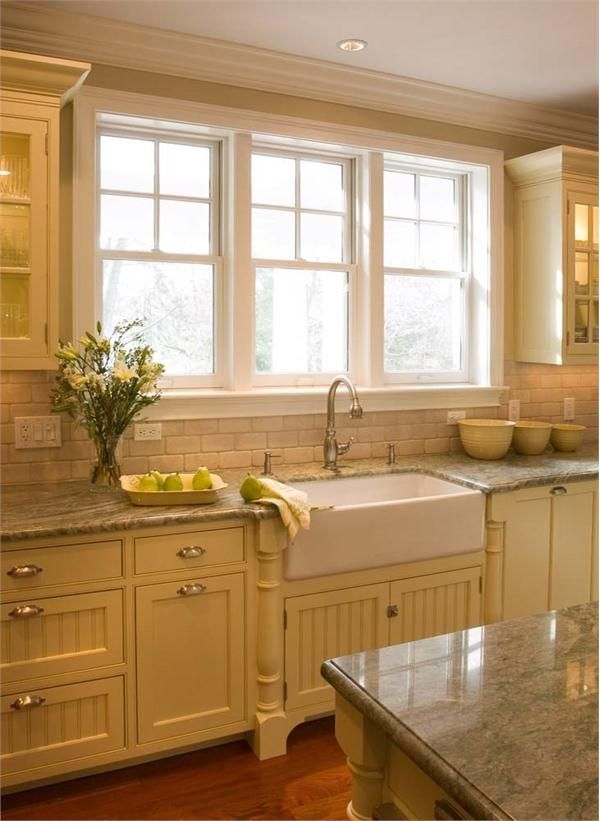 Bright Country Kitchen from Crown Point Cabinetry, love these cabinets and that sink,