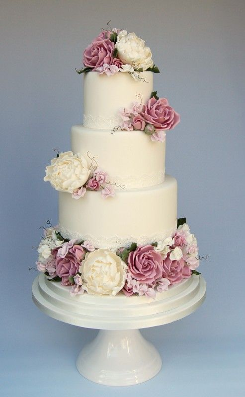 Tiered wedding cake with lilac and white flowers