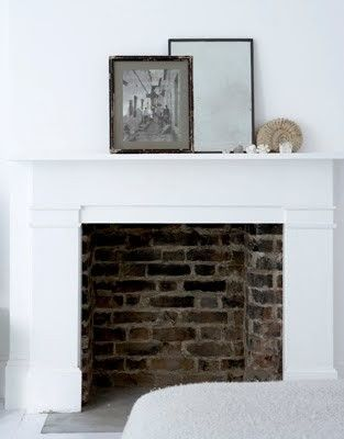 Looks exactly like my fireplaceClean and White with Unexpected Exposed Brick Fireplace would look great with yellow walls