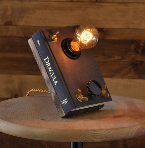 This is a book light, pun intended, made from a repurposed novel of Dracula by Bram Stoker. The dial on the front is actually a rotary switch that
