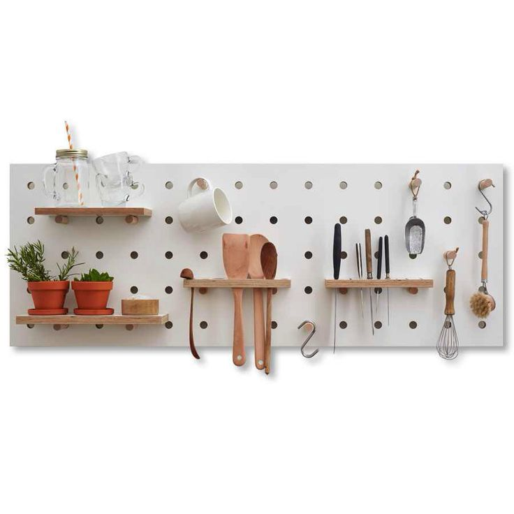The Kreisdesign plywood Chef's Edition pegboard comes with a knife rack, ladle holder & condiment tray. Great way to organise your kitchen.