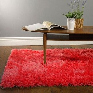 Red Shaggy Sheepskin Rug. This rug brings glamour to you room and is a super soft rug. http://www.therughouse.co.uk/sheepskin-rugs