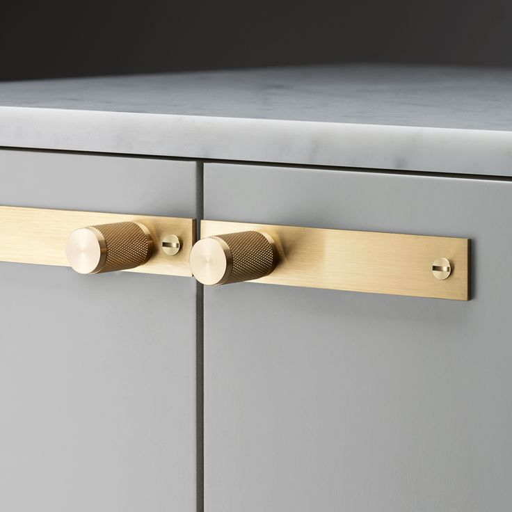 A Furniture Handle made from solid metal. A solid base with diamond-cut knurled handle detailing, including a rectangular back plate finished with penny...