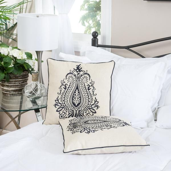 Spruce up the look of your living space with an affordable addition. This 18-inch pillow set features blue embroidered whimsical pattern over cream colored line