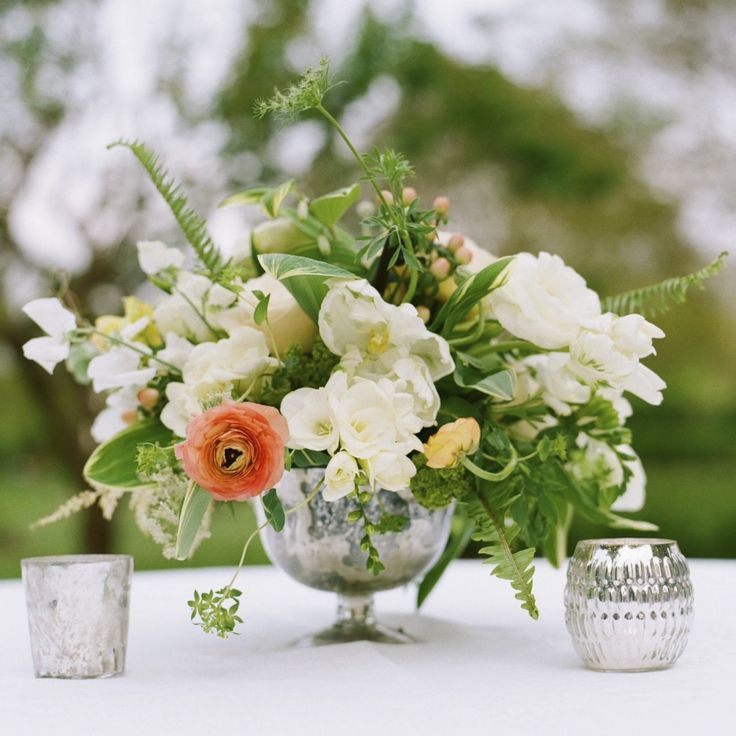 Spring centerpiece in footed mercury glass bowl with
