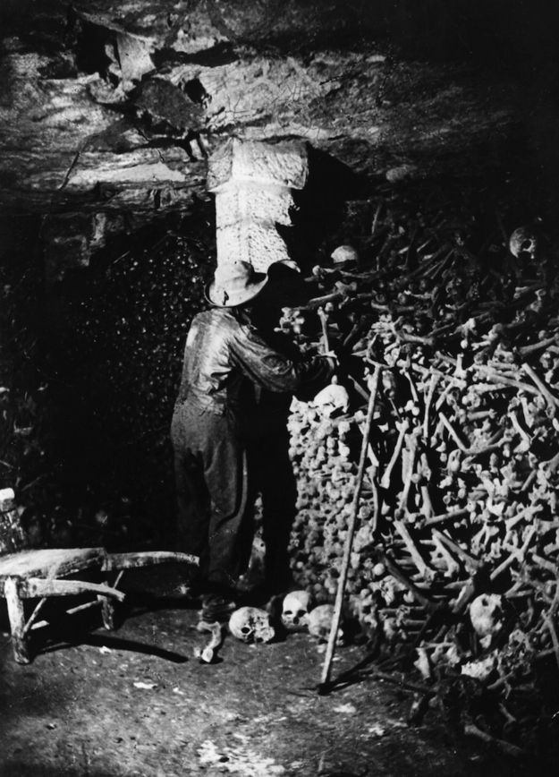 The Catacombs were built and conceived of in the late 18th century. Mass graveyards around Paris were overflowing, and so the bones were exhumed and arranged in the existing subterranean tunnels of the citys ancient quarry.