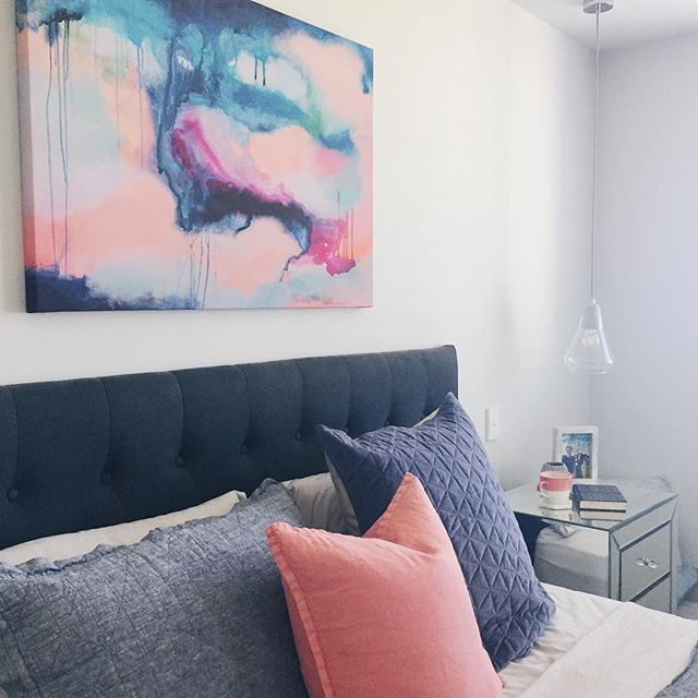 // OBSESSED with this art! abstract art master bedroom grey headboard mirror side tables pendant lights