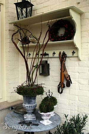 A Fall and Winter decoration in the garden. Use an old bookshelf and a table to create a corner to decorate the season. With an Autumn wreath and vintage skates this will look good for months. http:www.songbirdblog.com