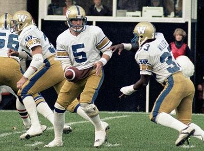 Blue Bomber quarterback #5 Dieter Brock Hands the ball off to #33 halfback William Miller in CFL action during the 1980 season vs the Ottawa Rough Riders at Lansdowne Park in Ottawa.