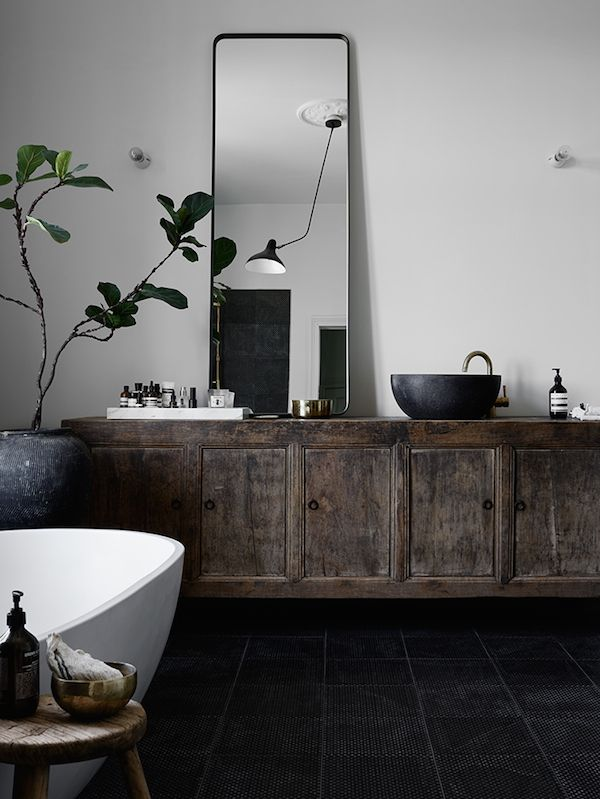 Black tile floors add drama, while also anchoring a space. Added bonus: won't show dirt!