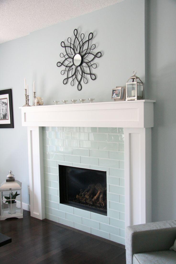 Smoke Grey Glass tile on fireplace in unusual size.