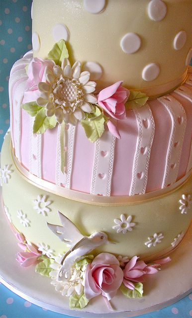 A hummingbird wedding cake. The colors are very spring and the hummingbird on the bottom tier is super cute.