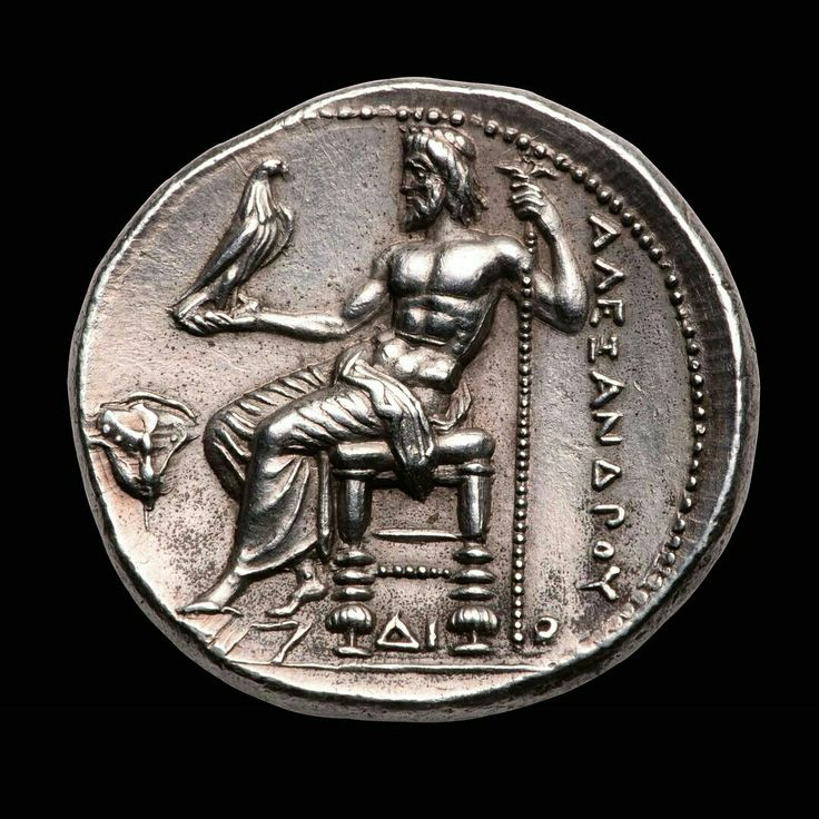 Silver tetradrachm minted under Alexander the Great circa 325BCE and showing a seated Zeus with a eagle on his right arm