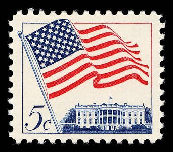 The flag waves over the White House in this 1963 stamp.